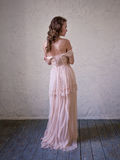 Fashion portrait of beautiful woman in a long pink dress. royalty free stock photography