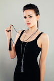 Fashion Portrait of Beautiful Woman Model in Black Cloth. And Silver Jewelry royalty free stock photography