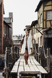 Fashion portrait of beautiful woman in old vintage street Royalty Free Stock Photography