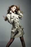 Fashion portrait beautiful woman in the raincoat Royalty Free Stock Photography