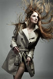 Fashion portrait beautiful woman in the raincoat Royalty Free Stock Image
