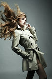 Fashion portrait beautiful woman in the raincoat Stock Photos