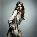 Fashion portrait beautiful woman in the raincoat Stock Photo