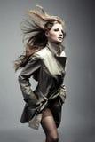 Fashion portrait beautiful woman in the raincoat Stock Image