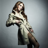 Fashion portrait beautiful woman in the raincoat Stock Photos