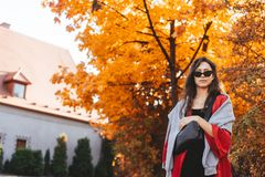 Fashion portrait of beautiful woman in autumn park. Fashion portrait of beautiful woman in stylish clothes in autumn park royalty free stock photography