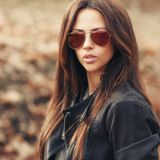 Fashion portrait of beautiful woman in sunglasses stock photography
