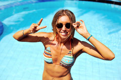 Fashion portrait of beautiful woman in swimming pool Royalty Free Stock Images