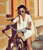 Fashion portrait of beautiful woman on a vintage bicycle Stock Images