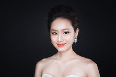 Fashion portrait of beautiful young asian woman in white dress o royalty free stock photo
