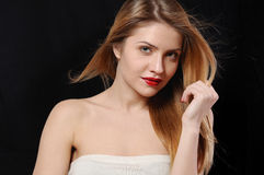 Fashion portrait of beautiful young blonde woman on black backgr Stock Image
