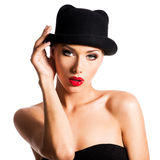 Fashion portrait of a beautiful young girl wearing a black hat. Stock Image