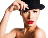 Fashion portrait of a beautiful young girl wearing a black hat. Royalty Free Stock Images