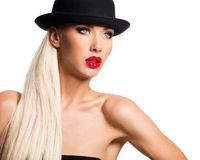 Fashion portrait of a beautiful young girl wearing a black hat. Stock Photo