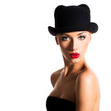 Fashion portrait of a beautiful young girl wearing a black hat. Royalty Free Stock Photo