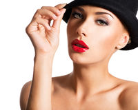 Fashion portrait of a beautiful young girl wearing a black hat. Royalty Free Stock Image