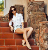 Fashion portrait of a beautiful young sexy woman wearing sunglas Royalty Free Stock Photo