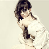 Fashion portrait of a beautiful young sexy woman wearing sunglasses Royalty Free Stock Images
