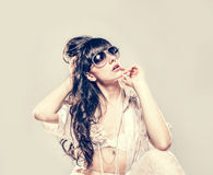 Fashion portrait of a beautiful young sexy woman wearing sunglasses Royalty Free Stock Image