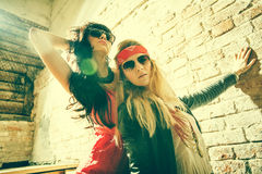 Fashion portrait of a beautiful young sexy womans wearing sunglasses. Royalty Free Stock Photo