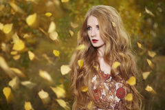 Fashion portrait of a beautiful young woman. In autumn forest. Beauty autumn Stock Photo