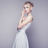 Fashion portrait of beautiful young woman with blond hair Stock Photography