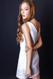 Fashion portrait of beautiful young woman with blond hair. Girl in a white summer dress on a black background Royalty Free Stock Photos