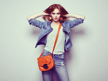 Fashion portrait of beautiful young woman with handbag Royalty Free Stock Photos