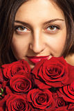Fashion portrait of a beautiful young woman with roses Royalty Free Stock Image
