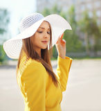 Fashion portrait of beautiful young woman in the straw hat Royalty Free Stock Photography