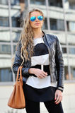 Fashion portrait of a beautiful young woman in sunglasses Royalty Free Stock Photo