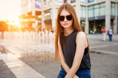 Fashion portrait of beautiful young woman in sunglasses stock photo