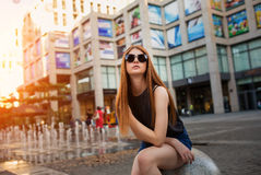 Fashion portrait of beautiful young woman in sunglasses stock image