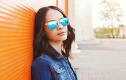 Fashion portrait of beautiful young woman in tsunglasses Stock Photo