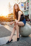 Fashion portrait of beautiful young woman, with view modern city stock images