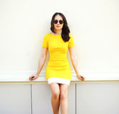 Fashion portrait of beautiful young woman wearing a yellow dress Stock Image