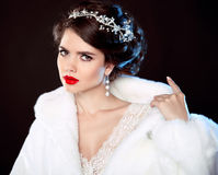 Fashion portrait of beautiful young woman in white fur coat with Stock Image