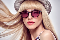 Fashion Portrait Blond Girl in Stylish Sunglasses. Fashion Portrait Sexy Blond Model in Stylish Sunglasses. Beauty Sensual Lady, Shiny straight hair, fashion Stock Image