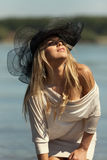 Fashion Portrait of Blond Woman Wearing Sun Hat Stock Photos