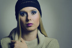 Fashion portrait of a blond woman wearing a turtleneck and a hat Stock Photo