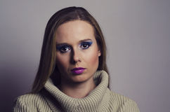 Fashion portrait of a blonde woman wearing a turtleneck Royalty Free Stock Photography