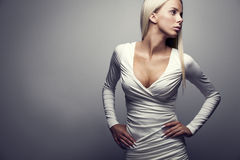 Fashion portrait of a blonde woman in white dress Royalty Free Stock Image