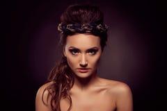 Fashion portrait of brown-eyes  woman. Gold tiara. Orange yellow Royalty Free Stock Images
