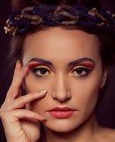 Fashion portrait of brown-eyes  woman. Gold tiara. Orange yellow Royalty Free Stock Photos