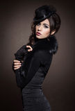 Fashion portrait of a brunette woman in black clothes Royalty Free Stock Photos