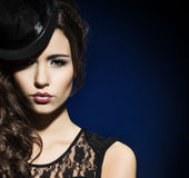 Fashion portrait of a brunette woman in black clothes Stock Photo