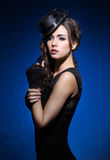 Fashion portrait of a brunette woman in black clothes Stock Photography
