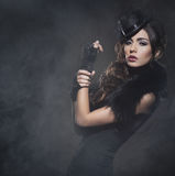 Fashion portrait of a brunette woman in black clothes Stock Image
