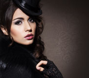 Fashion portrait of a brunette woman in black clothes Royalty Free Stock Images