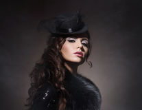 Fashion portrait of a brunette woman in black clothes Royalty Free Stock Photography